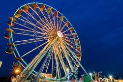 Ferris wheel with outdoor long exposure at twilight.