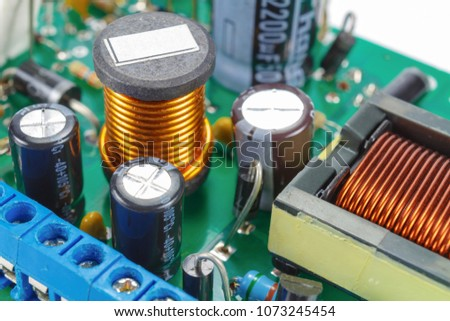 Ferrite choke and electrolytic capacitors mounted on the circuit Board