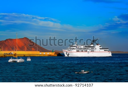 Ferry boat approaches pier at Corralejo harbor; Fuerteventura, Canary islands, Spain