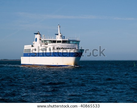 Ferry boat sailing into a port