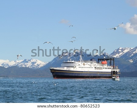 Ferry crossing the Kachemak Bay on a sunny summer day with seagulls