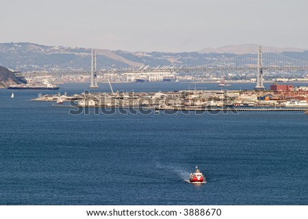 Ferry in San Francisco Bay with bay bridge in the background