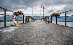 Ferry pier on the Lake Neuchatel in the city of Estavayer-le-Lac