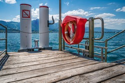 Ferry pier on the shore of the Lake Thun in municipality Oberhofen, canton Bern, Switzerland