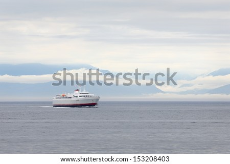 Ferry, Washington State, Olympic Peninsula. The ferry, Carrying passengers and vehicles, from Port Angeles in Washington State to Victoria\'s Inner Harbor. British Columbia, Canada.