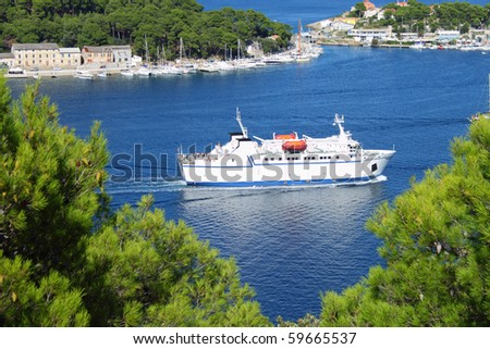 Ferryboat entering port of Mali Losinj, Croatia