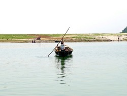 ferryman on Jamuna River, Bangladesh