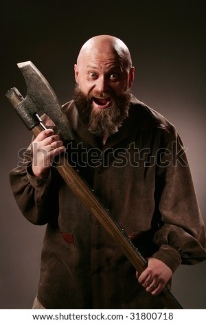 Fervent bald-headed man with old big axe
