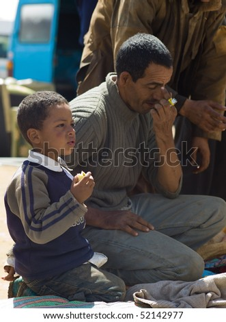 FES - APRIL 16: Father and son sell products at a market (souk) in a village near Fes in Morocco April 16, 2010 Fes, Morocco.