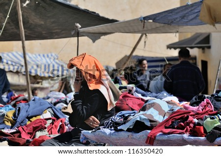 FES - MARCH 09: Arabic people at a market (souk) in a city Fes in Morocco. Fes is a historic city listed in UNESCO. March 09, 2012 Fes, Morocco.