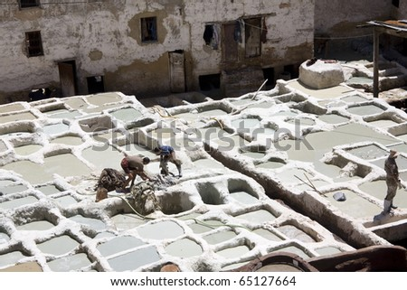 FES, MOROCCO, AFRICA - APRIL 10: men at work in a tannery in Fes on April 10, 2010 in Fes, Morocco, Africa. Tannery is the best resource of work in the city of Morocco