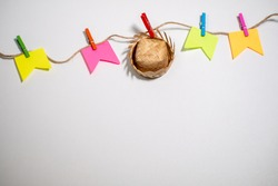 Festa junina theme background. a traditional straw hat and flags hangs by colorful pegs on a rope. white background. Space to text