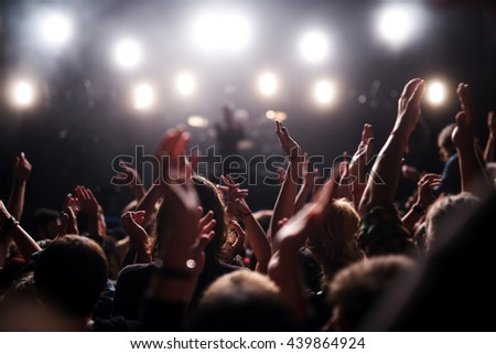Festival crowd raising their hands in the air. #439864924