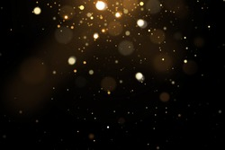 Festive abstract christmas texture, golden bokeh particles and highlights on dark background. High quality photo