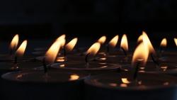 festive background burning candle, mourning photo of a blazing fire