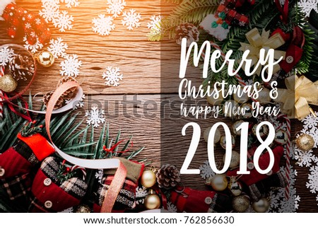 festive background concept with christmas decorating items on wooden floor with light filter #762856630