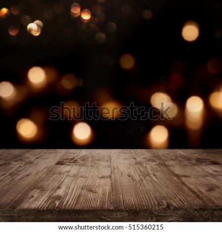 Festive background for celebratory moments and a concept in front of a empty wooden table with golden bokeh #515360215