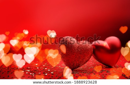 Festive background for valentine's day with copy space. Heart shaped two hearts on a red background with sparkles and bokeh. Stock photo ©