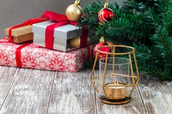 Festive background with different gift boxes, Christmas tree and gold candlestick, horizontal, copy  space