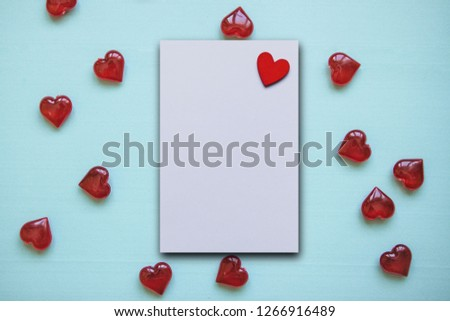 Festive background with many hearts for Valentine's Day or another holiday or love event. In the middle is a white space with a heart for text. #1266916489