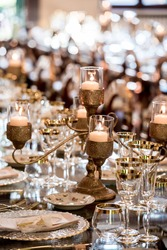 Festive banquet table decorated in gold and gilded hues for Christmas