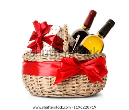 Festive basket with bottles of wine and gift on white background Stock photo ©