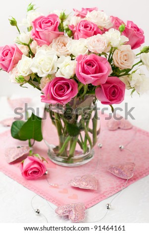 festive bouquet of pink and white roses in vase