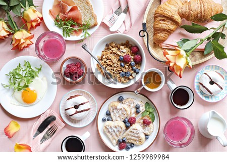 Festive brunch or breakfast set for Valentines day, Mothers day or Easter. Pink background. Overhead view . #1259989984