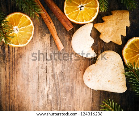 Festive cakes and orange circles on a rustic wooden table.