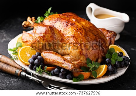 Festive celebration roasted turkey with gravy for Thanksgiving or Christmas
