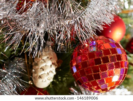 Festive Christmas background of a decorated with balls xmas tree fragment
