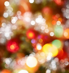 Festive Christmas background of defocused decorated xmas tree bokeh composition