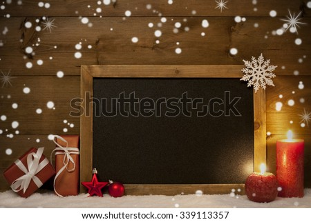 Festive Christmas Card With Chalkboard, Red Gifts Or Presents, Christmas Balls, Snowflakes And Candles. Christmas Decoration With Rustic, Vintage Brown Wooden Background. Copy Space For Advertisement