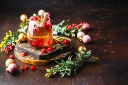 Festive Christmas Cranberry and rosemary cocktail with ice on the dark background. Alcoholic or non-alcoholic cocktail.