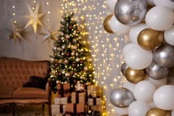 festive christmas decor with golden and silver air balloons