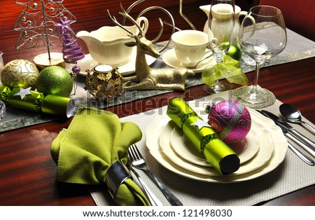 Festive Christmas Eve Dinner Table Setting on dark oak table with lime green and pink accents.