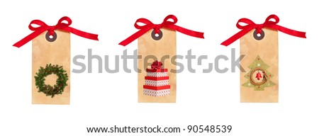 Festive Christmas gift tags tied with red ribbon isolated on a white background