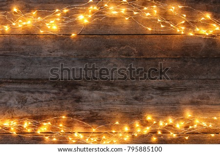 Festive christmas lights on wooden background