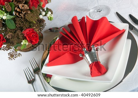 stock photo Festive Christmas or wedding table with red napkins on a white