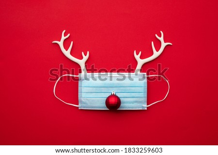 Festive christmas reindeer made from face mask and decorations stock photo