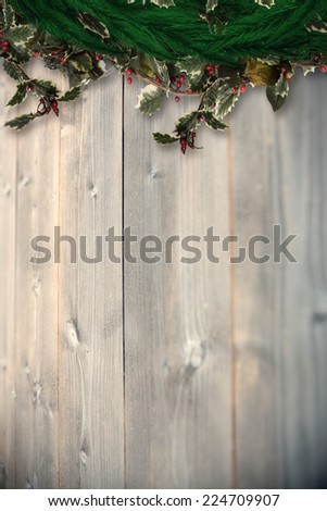 Festive christmas wreath against bleached wooden planks background #224709907