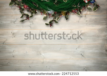 Festive christmas wreath against bleached wooden planks background #224712553