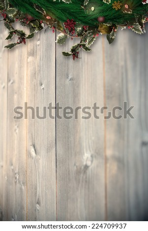Festive christmas wreath with decorations against bleached wooden planks background - Shutterstock ID 224709937