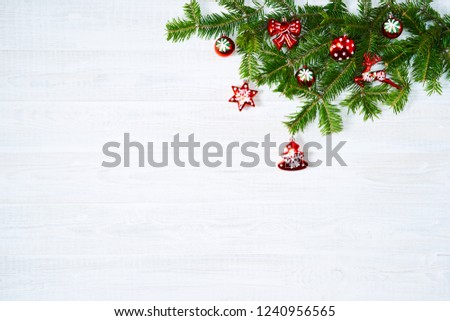 Festive composition of Christmas decorations on white wooden background. Flat lay with copy space. New year holiday frame. #1240956565