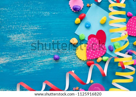 Festive confetti background heart candy color saturated. Wood old blue background with copy space flat lay #1125916820