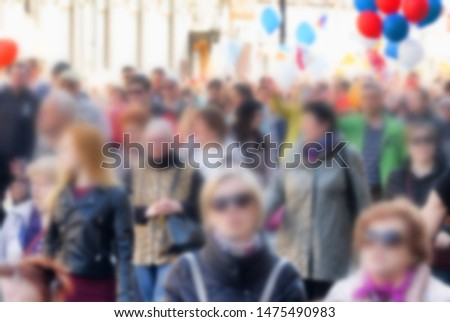 Festive crowd at city festival . Blurred anonymous crowd in the metropolis.