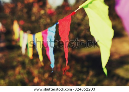 Festive decorations of colored flags. Toned style instagram filters