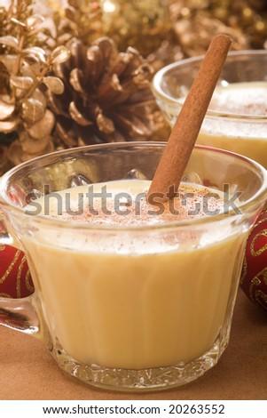 Festive eggnog served with a cinnamon stick.