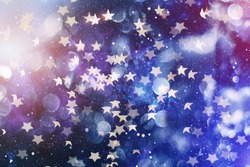 Festive elegant abstract background with bokeh lights and stars  .