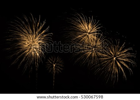 Festive fireworks colorful display isolated in bursting shapes on black background. Beautiful light for celebration. Show explosion happy new year wallpaper. #530067598